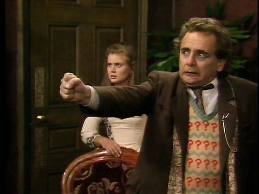 Sylvester McCoy reacts with horror when John Nathan-Turner suggests tattooing a question mark on his forehead